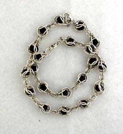 Garnet beads in silver as a bracelet