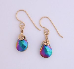 AB earrings wrapped in gold