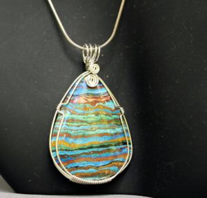 Rainbow Calsilica Pendant wrapped with Sterling Silver wire