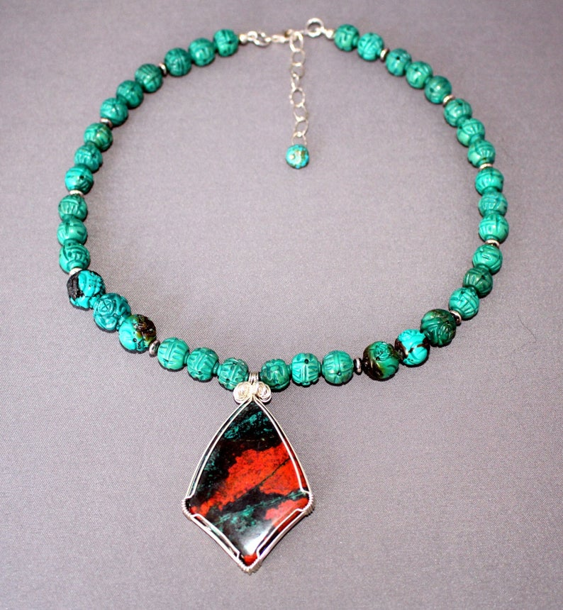 Sonoran Sunrise Jasper Pendant on a necklace of textured Turquoise beads