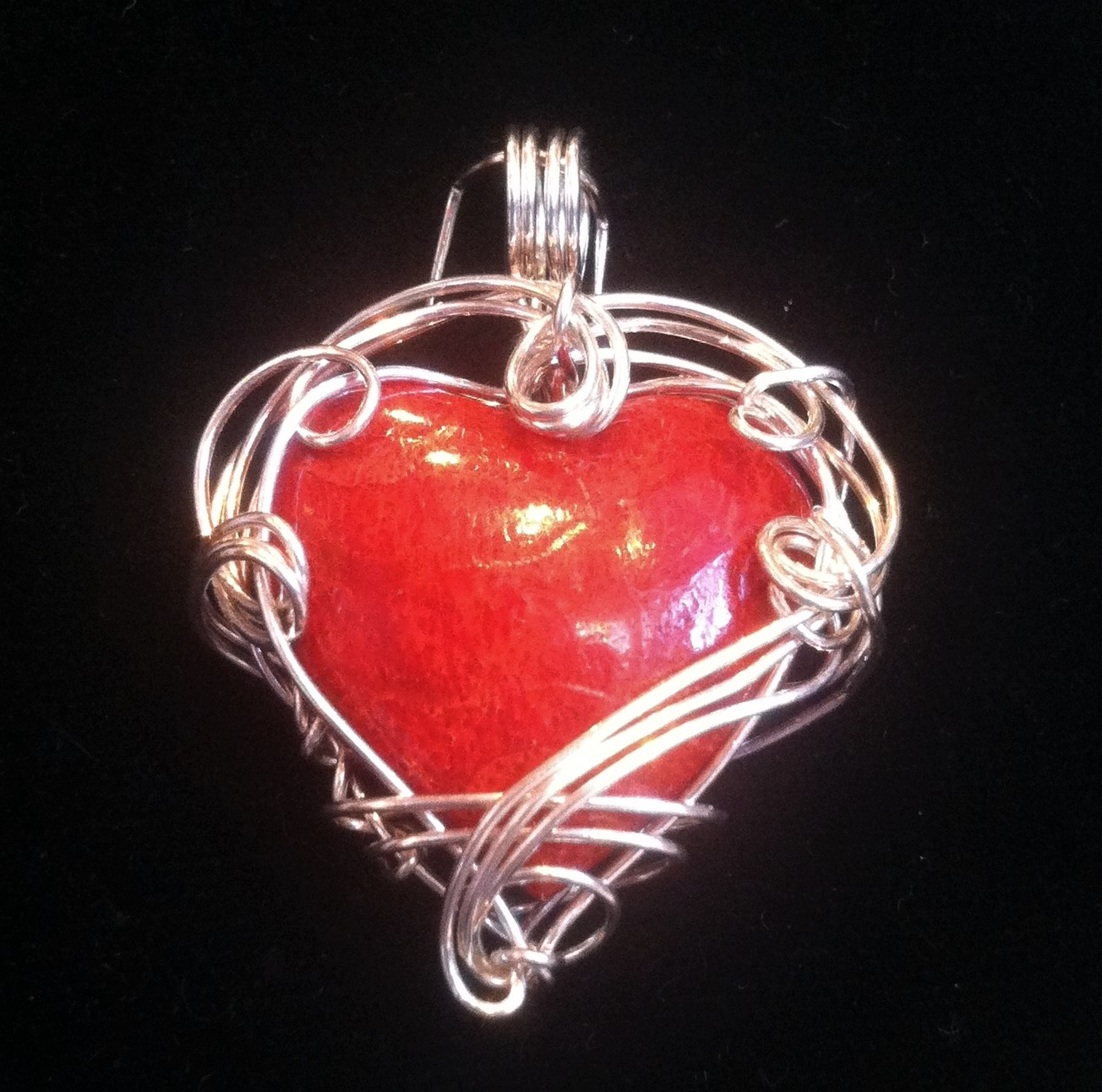 Dyed sponge coral heart pendant wrapped in sterling silver swirls